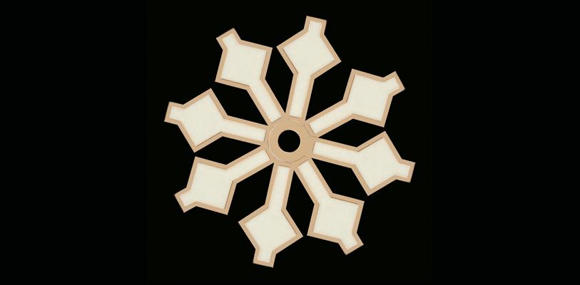 Superposición de agujas Tudor Snowflake formando el patrón de un copo de nieve.