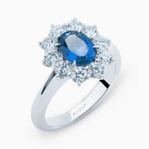 Ring with Central Sapphire and Diamond Border