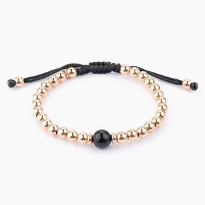 String bracelet wuth gold pearls and Onyx