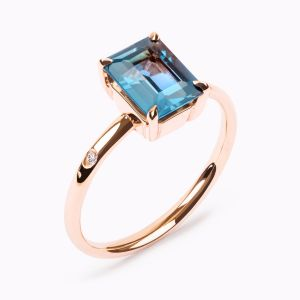 Rose gold ring with topaz