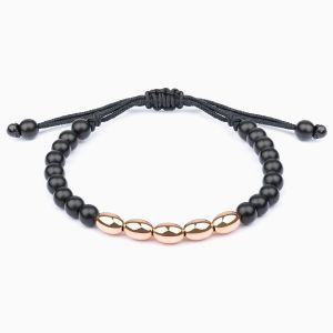 String bracelet with golden and onyx beads