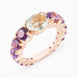 Rose gold ring with precious stones