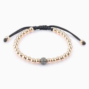 String bracelet, gold pearls and black diamonds