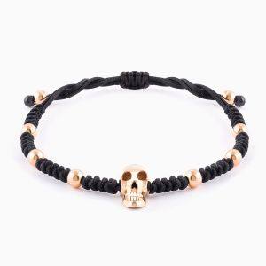 Black string bracelet with rose gold skull