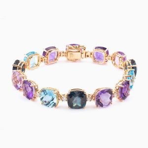Rose gold bracelet with blue topazes and amethysts