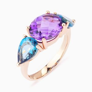 Rose gold ring with  amethyst and topazes
