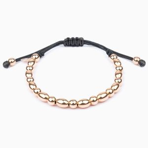 String bracelet with golden beads